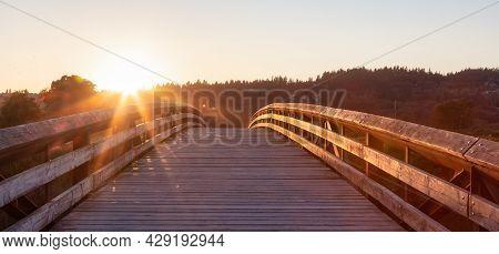 Bridge Going Over A River In A City Park. Sunny Summer Sunset. Colony Farm Regional Park, Port Coqui