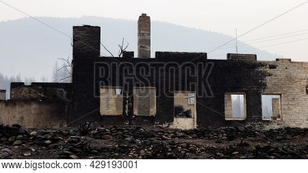 Fire Debris Of Houses In A Small Town With Smoke In Sky. Caused By Forest Wildfires In Lytton, Briti
