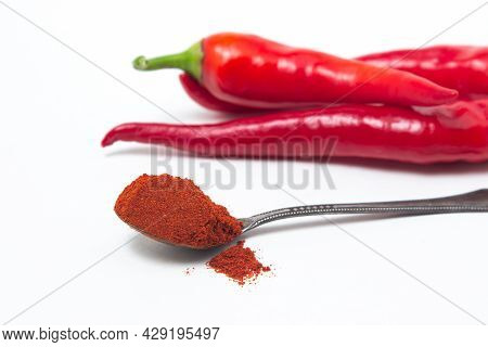 Red Hot Peppers And Red Ground Peppers On A White Background. Chili Pepper Isolated