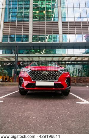 Red Hyundai Tucson N-line Front View. Korean Compact Crossover Suv Third Generation Parked In Front
