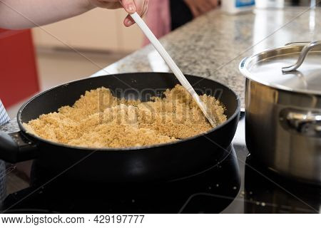Toast The Breadcrumbs In The Frying Pan On The Ceramic Hob