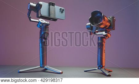 Russia, Moscow - July 29, 2021: Stabilizers For Cameras And Phones. Action. New Professional Steadic