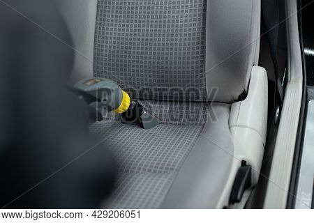 Man Car Detailing Studio Worker Cleaning Car Textile Upholstery