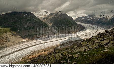 Great Aletsch Glacier. Switzerland, Eastern Bernese Alps In The Swiss Valais Canton. Largest Glacier