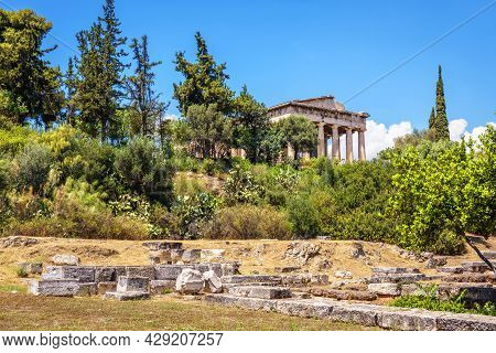View Of Greek Agora, Athens, Greece. Famous Old Temple Of Hephaestus, Landmark Of Athens In Distance