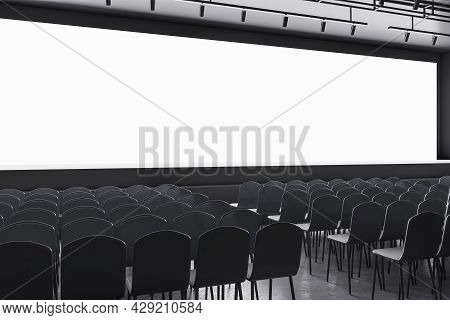 Contemporary Grey Auditorium With Seating And Empty Screen With Mock Up Place For Your Advertisement
