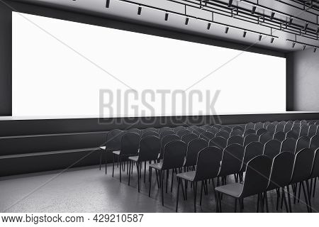 New Grey Auditorium With Seating And Empty Screen With Mock Up Place For Your Advertisement. Show Pr