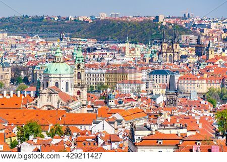 Baroque Cupola Of Saint Nicholas Church In Lesser Town And Old Town Towers On Background, Czech Repu