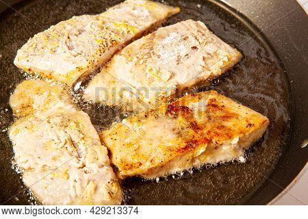 Fish Marinade Preparation Steps: Frying Sea Bass Pieces