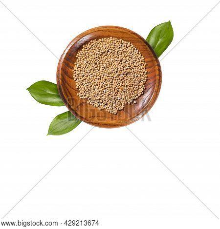 Organic White Mustard Seeds In The Wooden Bowl - Sinapis Alba