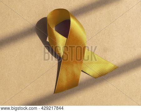 Yellow Satin Ribbon As Medical Symbolic Loop.