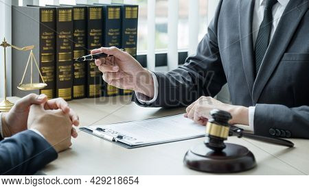 Lawyer Hand Holding Pen And Providing Legal Consult Business Dispute Service To The Man At The Offic