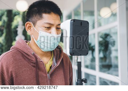 The Asian Tourist Man Has Checked Body Temperature With A Thermal Temperature Scanner Detector, New