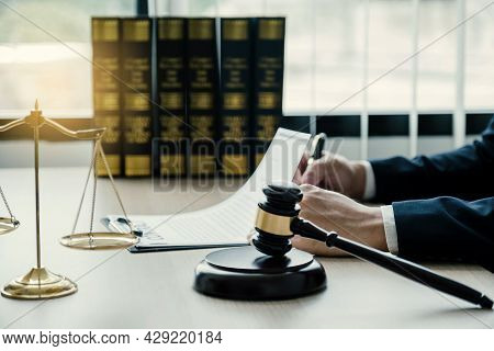 Gavel Hammer, Lawyer Hand Holding Pen And Providing Legal Consult Business Dispute Service At The Of