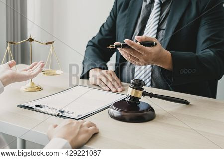 Lawyer Hand Holding Pen And Providing Legal Consult Business Dispute To The Man.
