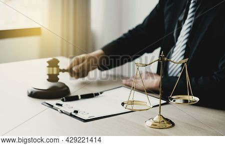 Justice Scale Standing In Front Of The Lawyer Providing Legal Consult Business Dispute Service At Th