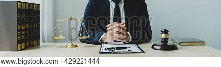 Hand, Lawyer Sitting And Providing Legal Consult Business Dispute Service At The Office With Justice