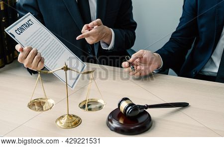 Hand Holding Pen, The Lawyer Providing Legal Consult Business Dispute Service At The Office With Jus