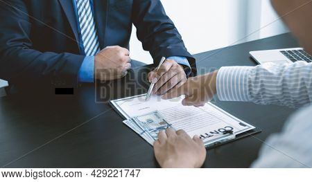 Government Officials Hand Sign The Contract For Receiving Bribe Money From Businessman, The Concept