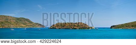Panorama of Island of Spinalonga with old fortress former leper colony and the bay of Elounda, Crete island, Greece