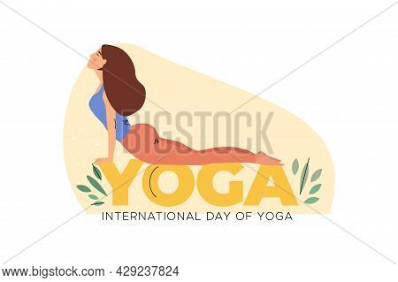 Woman In Cobra Pose Laying On Word Yoga. International Day Of Yoga
