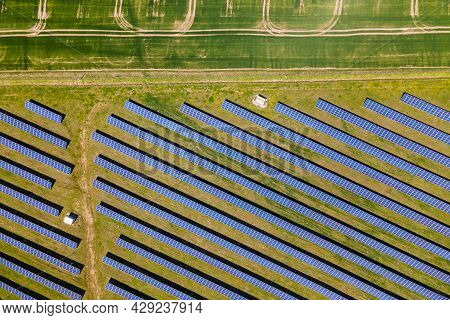 Aerial View Of Big Sustainable Electric Power Plant With Many Rows Of Solar Photovoltaic Panels For