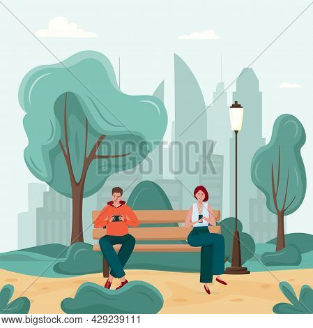 Gadget Addiction, Man And Woman On The Park Bench Dependent On Smartphones. People Glued To A Screen