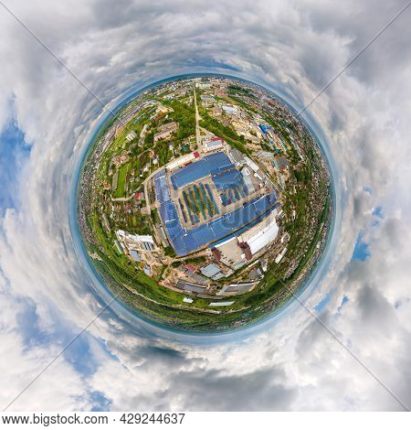Little Planet With Big Sustainable Electric Power Plant With Many Rows Of Solar Photovoltaic Panels