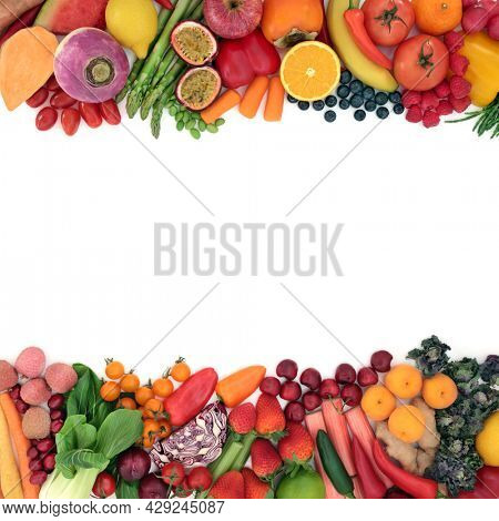 Healthy fruit, vegetable background border for immune boosting vegan diet high in antioxidants that neutralize free radicals, also containing anthocyanins, lycopene, carotenoids, fibre, vitamins.