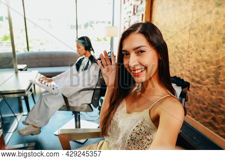 Young Female Attractive Millenial Asian Mixed European Race Youtuber Waving At Audience Online While