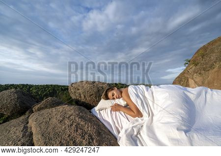 A Sleeping Woman In The Open Air In Nature. A White Bed Was Spread Out On The Top Of The Mountain. C