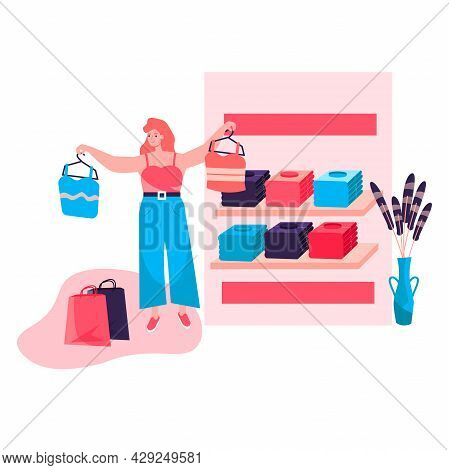 Shopping Woman Concept. Buyer Chooses New Stylish Clothes Standing Near Racks At Showroom Shop. Cust