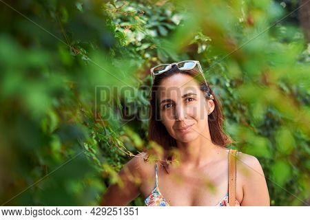 Beautiful woman portrait in nature. Beauty Woman face Portrait nature. Beautiful model woman portrait in nature. Woman smiling portrait in nature background. Beautiful woman smiling in nature. Woman portrait in nature. Woman face. Woman portrait in nature