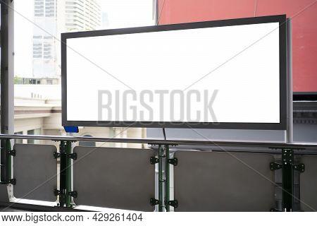 Empty White Billboard On Train Station. Mock Up Blank Large Billboard On Glassy Showcase Window In S
