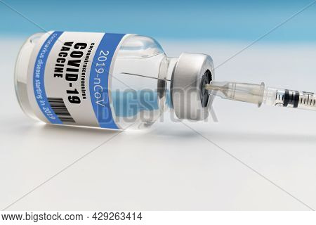 Vaccination Against The New Corona Virus Sars-cov-2. A Syringe Being Drawn Up With Sars-cov-2 Vaccin