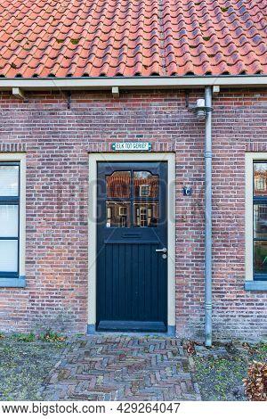 Veenhuizen, The Netherlands - April 16, 2021: Entrance Door Historic House Veenhuizen With Historica