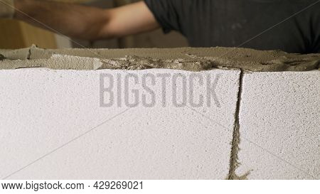 A Wall Made Of White Gypsum Partition Blocks, An Interior Partition. Erection Of Walls From A White