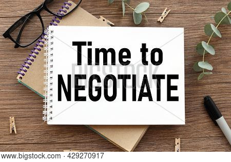Time To Negotiate. Text On White Paper On Wood Table Background