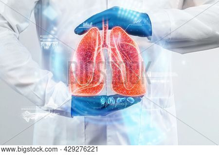 The Doctor Looks At The Hologram Of Lungs, Checks The Test Result On The Virtual Interface And Analy