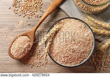 Wheat Bran, Kernels And Spikelets On Wooden Table, Flat Lay