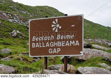 Ballaghbeama Gap, Ireland-  July 9, 2021: The Road Sign At The Top Of Ballaghbeama Gap In The Mounta