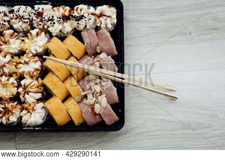 Traditional Delicious Fresh Sushi Roll Set On Wooden Background. Sushi Roll With Rice, Cream Chees,
