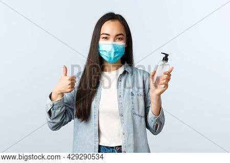 Social Distancing Lifestyle, Covid-19 Pandemic Preventing Virus Concept. Cheerful Asian Woman In Med