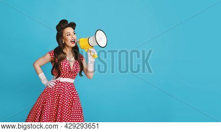 Pinup Woman In Retro Outfit Making Announcement, Shouting Into Megaphone On Blue Background, Banner