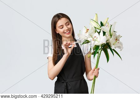 Shopping, Employees And Small Business Concept. Smiling Cute Flower Shop Owner In Black Apron Runnin