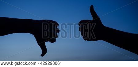 Thumb Up And Thumb Down Hand. Two Hands Showing Different Gestures. Yes Or No Silhouette. Like And D