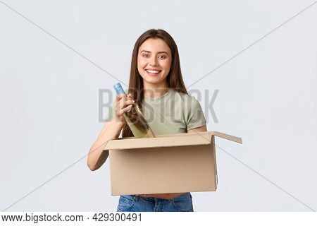Online Home Delivery, Internet Orders And Grocery Shopping Concept. Excited Woman Ordered Groceries