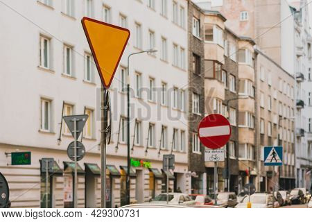 Triangular Red And Yellow Yield Traffic Sign. Give Way Road. City. Urban. Regulation. Rules. Transpo