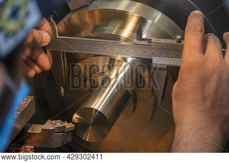 The Machine Operator Use Vernier Caliper Measure Brass Material Parts . The Metalworking Process By