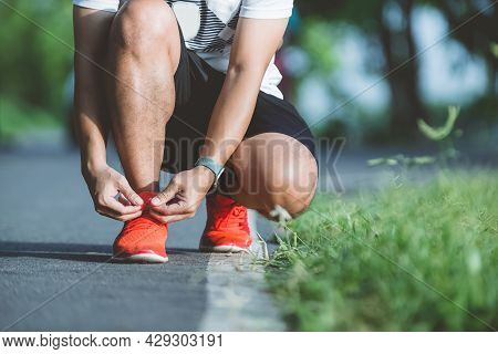 Running Shoes Runner Man Tying Laces For Autumn Run In Forest Park. Runner Trying Running Shoes Gett